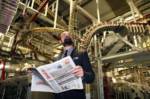 Evgeny Lebedev holds a freshly printed copy of the 'i' weekday newspaper on the day of the tabloid's launch in 2010. Photo: Bloomberg