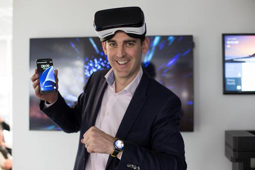 'I count my time here by launches, not years,' says Gary Twohig of Samsung, with the Gear VR headset and the S7 Edge. Photo: Mark Condren
