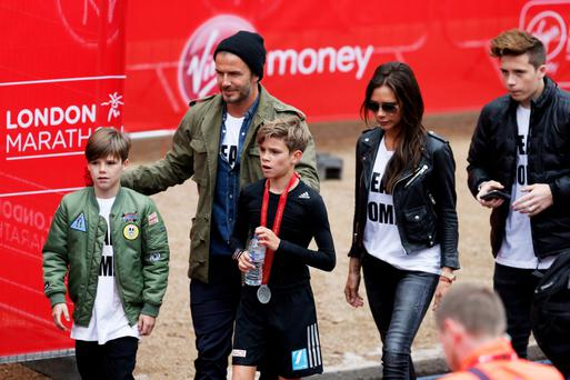 FAMILY MATTERS: Cruz, David, Romeo and Victoria Beckham. Cruz has just released his first single, 'If Every Day Was Christmas' Picture: Getty