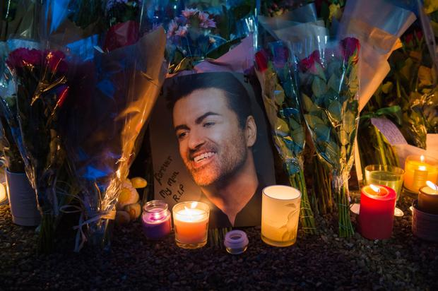 FANS' FAREWELLS: Tributes outside George Michael's house in Highgate, North London, following the singer's death on Christmas Day. Photo: PA