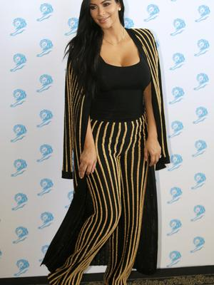 American television personality Kim Kardashian poses for photographers as she attends the Cannes Lions 2015 in Cannes, southern France, Wednesday, June 24, 2015. The Cannes Lions International Advertising Festival is a global meeting place for professionals in the communications industry. (AP Photo/Lionel Cironneau)