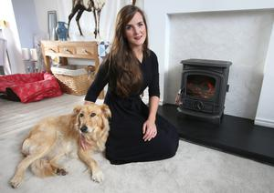 Alexa O'Byrne and her dog with her Stanley stove.