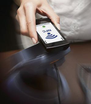 Phones are replacing cash and bank cards as a means to pay a bill