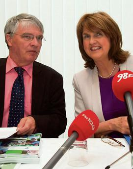 MAKE SURE YOUR CONTRIBUTIONS ARE UP TO DATE: Pensions Ombudsman Paul Kenny with Minister for Social Protection Joan Burton. Photo: Gareth Chaney/Collins