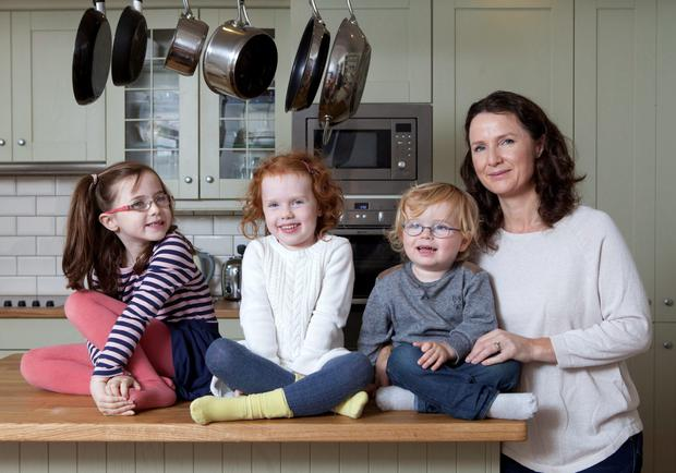 Andrea Mara with her children Elissa, 7, Nia, 5 and Matthew, 2, from Carriglea Downs in Dun Laoghaire. She used a price comparison website. Photo: Peter Houlihan