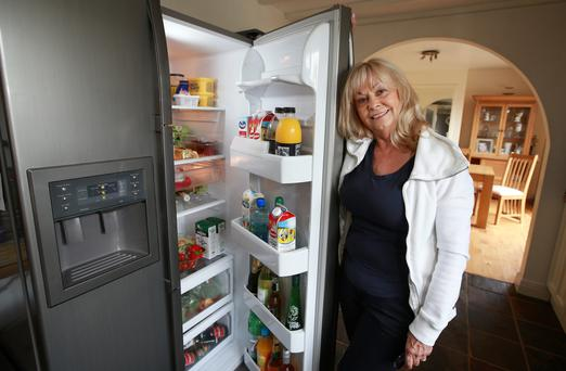 Freda Griffin pictured with her 10 year old American Fridge Freezer at her home in Rathfarnham.