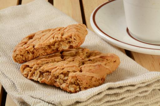 Peanut butter and oatmeal breakfast bars with a cup of coffee.