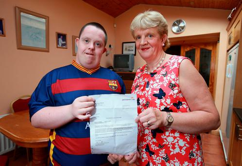 Philip Kelly with his mother, Mary, and the warning letter he recieved from Permanent TSB