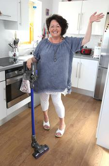 Karen Hoyne with her Dyson vacuum cleaner. Photograph: Damien Eagers