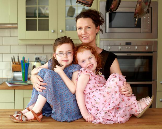 Working mum: Andrea Mara with her daughters Elissa and Nia. Photo: Ronan Lang