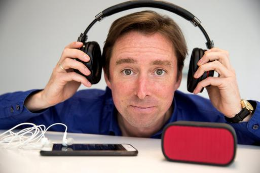 Adrian Weckler, technology editor, with Sony MDR1RBT headphones, Logitech UE miniboom wireless speaker and iPhone 6 Plus phone