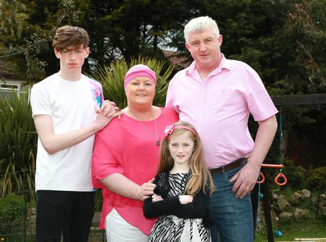 Deirdre Sullivan with her husband John, and their children Cara [7] and Sean [16] at their home in Walkinstown. Photo: Frank Mc Grath