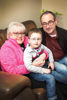 Easy to switch: Philomena and Stephen Lyons with grandson Reese McEndoo (3) at their Terenure home. Photo: Colin O'Riordan