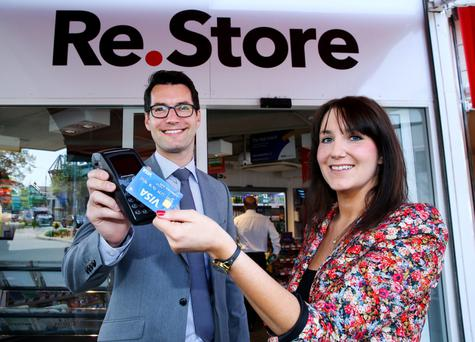 Philip Konopik, from Visa, with Eilis Firth, Re.Store brand manager, showing off a card