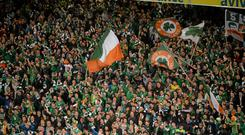 A section of Republic of Ireland supporters celebrate qualification for Euro 2016 after a 2-0 victory over Bosnia at the Aviva Stadium last November