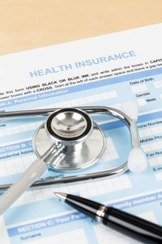 Health insurance is vital when a person with medical conditions is travelling abroad. Stock Image