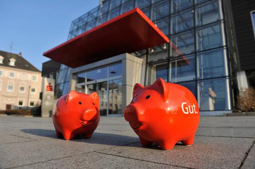 Sparkasse piggy banks outside one of the branches in Germany. The methods of the bank Sparkasse are winning over fans here, too — especially in the wake of the stories about people being left devastated by Irish banks over tracker mortgages. Photo: Stefan Kuhn