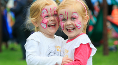 Fun in the sun: Twins Mia and Isabelle Kenny from Skerries during the Laya Healthcare City Spectacular last year, which runs again this July. Photo: Gareth Chaney, Collins