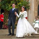 Big budget: Princess Eugenie and her new husband Jack Brooksbank outside St George's Chapel in Windsor Castle following their wedding