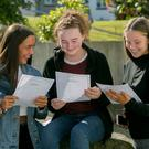 Ciara Rogerson from Sallynoggin, Aoife Swan from Ballybrack and Saoirse Mangan from Dun laoghaire analysing their Leaving Cert Results at Rockford Manor Presentation, Blackrock, Dublin on Tuesday. Photo: Gareth Chaney/Collins