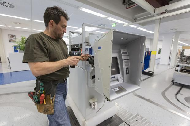 An ATM on the production line at Wincor Nixdorf's plant in Paderborn, Germany. Photo: Bloomberg