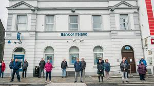Withdrawal: Residents of Ballyhaunis, Co. Mayo outside the local Bank of Ireland closed due to the pandemic. Photo : Keith Heneghan