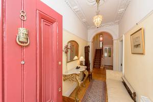 The front door of 8 Upper Leeson Street opens into a bright front hall with many period pieces