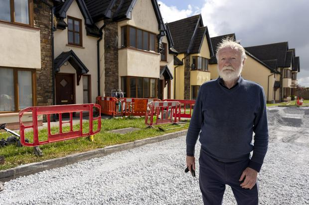 Councillor Jerome Scanlon pictured at an unfinished housing development in Ardagh, County Limerick. Photo: Don Moloney