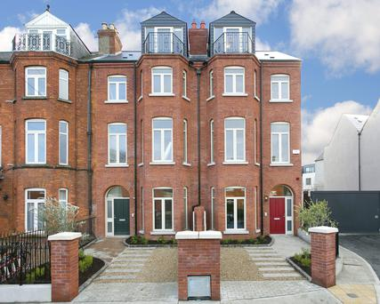 Red brick townhouses in Maxwell Square