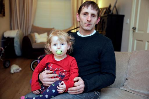 Conor McNally and his daughter Saoirse, age 2 at their home in Clonsilla, Dublin