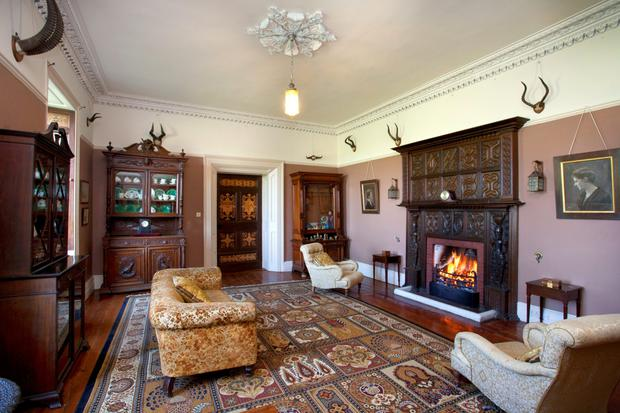 One of the reception rooms with open fire