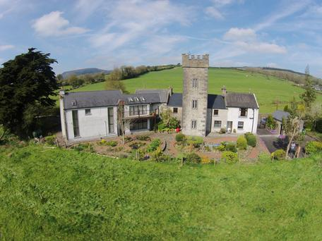 The property consists of a 16th-century tower house, farmhouse and a modern addition