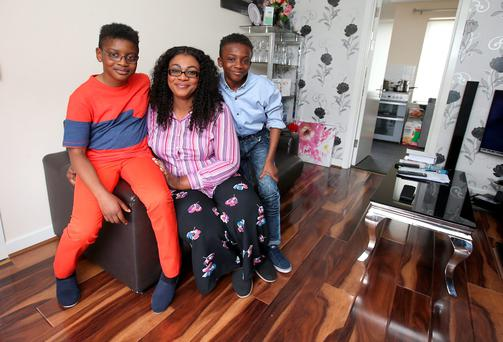 Mary Atinuke Abumere, left, with her sons, Israel (11), right, and Isaac (8) at their new home in Ballyfermot, Dublin