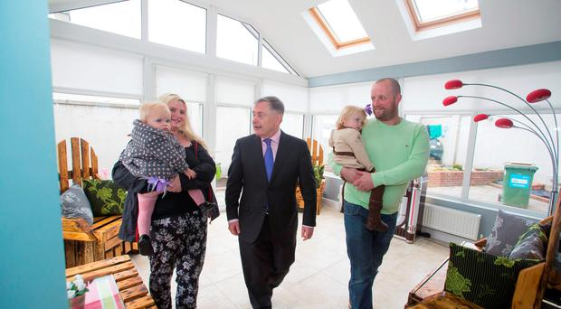Brendan Howlin with residents Josh and Mary Fortune and their children Bláthnaid and Keela in their new house at Parkton Mews in Enniscorthy