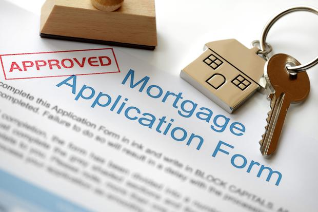 Many of the people being approved for a home loan are competing hard with each other for the few houses that are available. Stock image