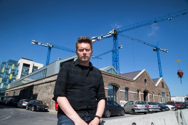 European base: John Meagher outside Airbnb's Grand Canal Dock HQ in Dublin. Photo: Colin O'Riordan