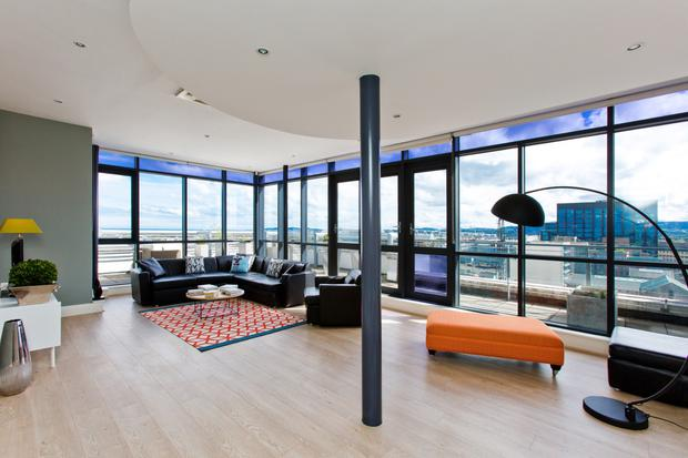 The Colourful Contemporary Style Living Area In This 12th Floor Waterfront  Apartment With Sweeping Views Over The Dublin Docklands.