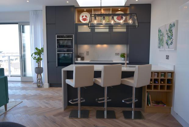 The contemporary-style kitchen on offer in all of the apartments