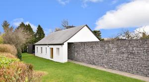 The original bungalow is still recognisable, but up close the place is transformed