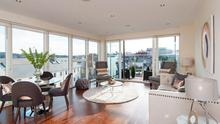 The main reception has floor to ceiling windows.