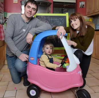 Sarah Lennon (29) Declan Butler (31) and Sienna Butler (2) in Sarah's parents' house in Knocklyon. Photo. Bryan Meade