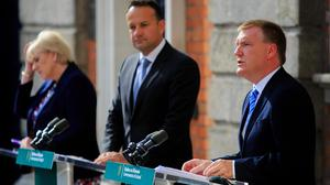 Public Expenditure and Reform Minister Michael McGrath speaks outside Dublin Castle alongside Justice, Social Protection, Community and Rural Development Minister Heather Humphreys (left) and Enterprise, Trade and Employment Minister Leo Varadkar. Photo: Gareth Chaney/Collins