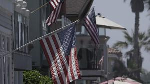 American flags on Independence Day. Photo: Bing Guan/Bloomberg