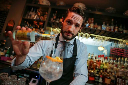 Are you being served? Gin connoisseur Alan Moore making a gin and tonic at Kinara Kitchen in Ranelagh Photo: Arthur Carron