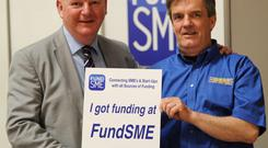 FundSME.ie CEO Nollaig Fahy with Sweeney's Garages Director Greig Sweeney
