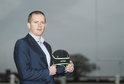 Mark Ganly, ceo of Contego Sports, with one of the head guards he and his wife developed after being moved by John Fogarty's story