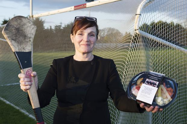 Helen McArdle with one of the ready meals she and husband Owen and sons Glen and Dan provide for players in the Galway GAA and Connacht rugby teams and other customers. Photo: Andrew Downes