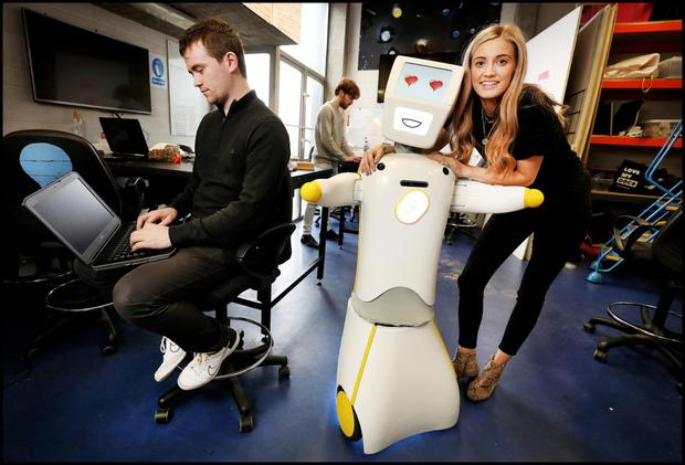 Stevie The Robot at the Robotics and Innovation Lab (RAIL) at TCD with Niamh Donnelly and Andrew Murtagh.