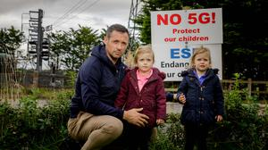 Research: Michael Moyles, with his twin daughters Muireann and Saoirse, outside their home in Enniscrone, Co Sligo. Photo: James Connolly