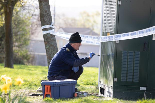 A garda forensics officer investigates the scene of a fire at a 5G mast near Letterkenny hospital, Donegal. Photo: North West Newspix